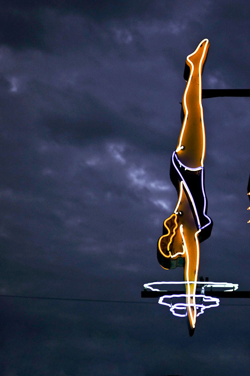 Woman diving neon sign