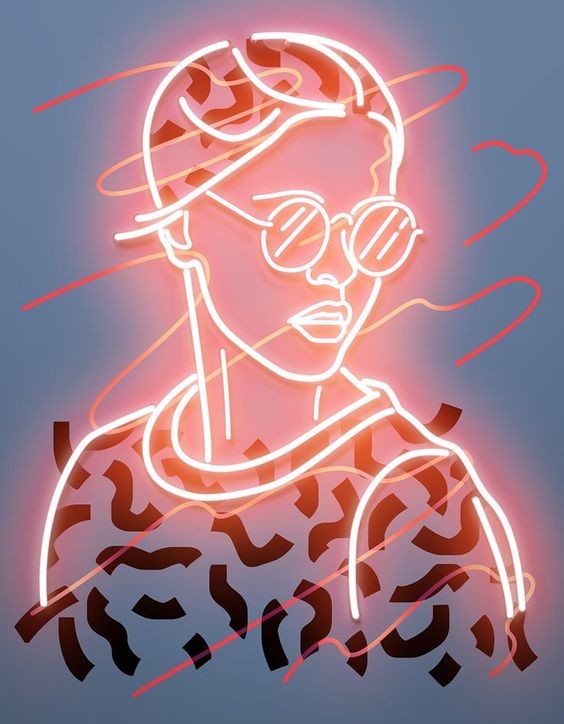 Aesthetic neon design of a girl with sunglasses, great inspiration for visual merchandising or in store display.