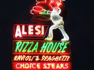 Using a neon sign for a business is quite popular, this one is for Alesi pizza night.