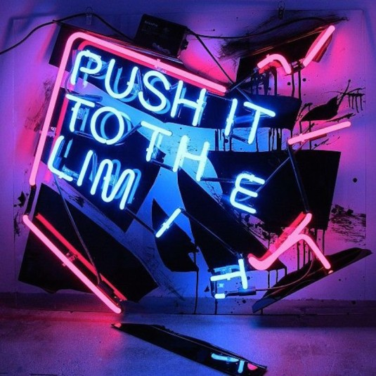 "Art installation using neon light and text ""Push it to the limit""."