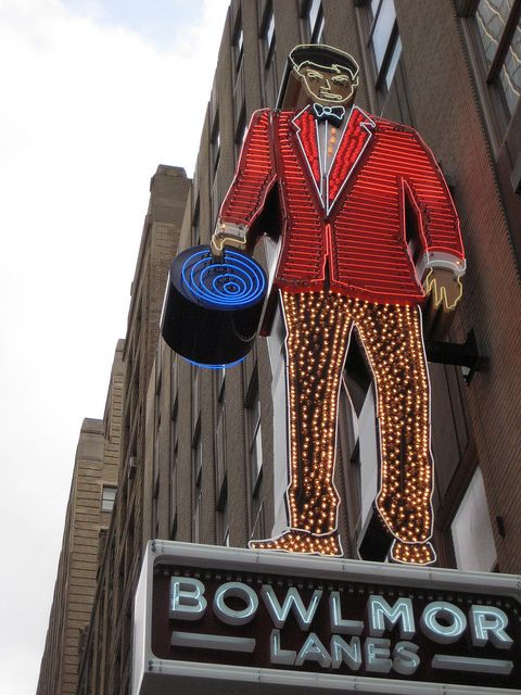 A sign representing a man's figure made entirely from neon for Bowlmor Lanes.