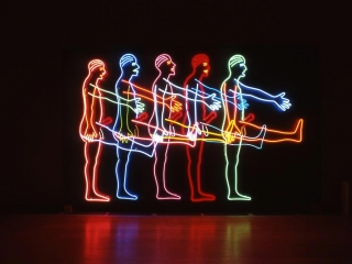 "A Bruce Nauman neon installation entitled ""Five Marching Men""."