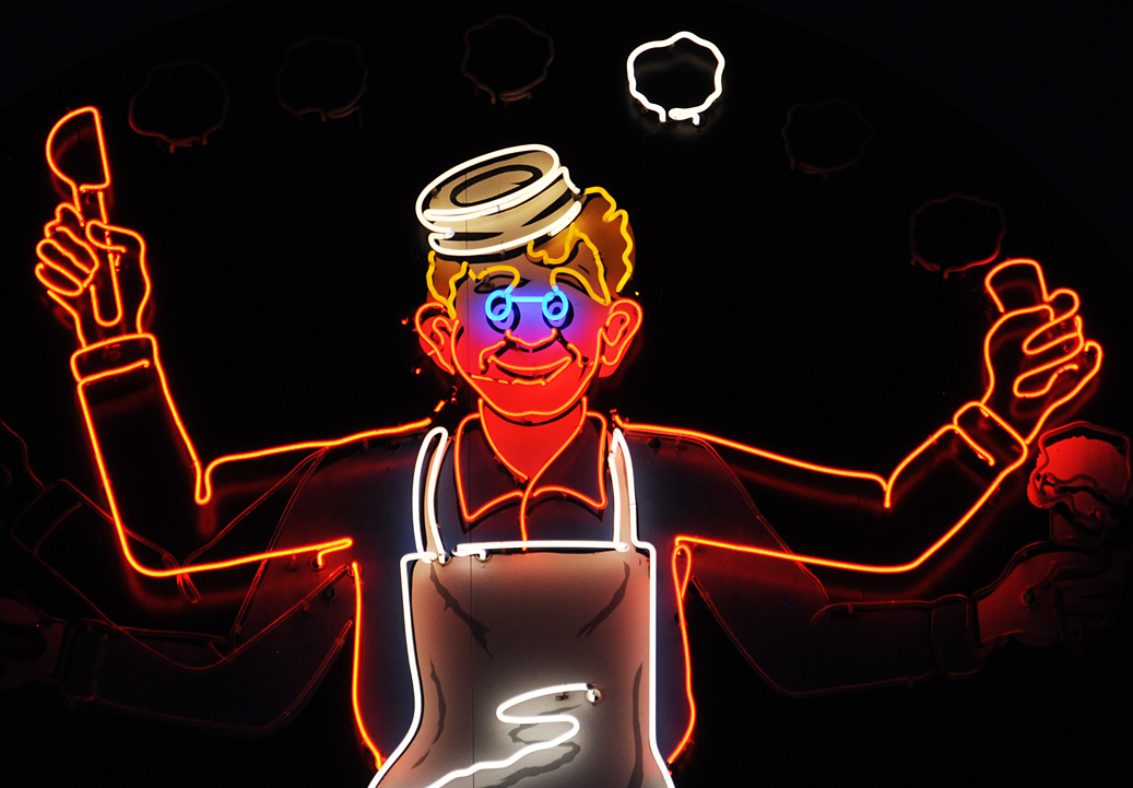 Chef figure made with neon light, a clever idea for a sign.