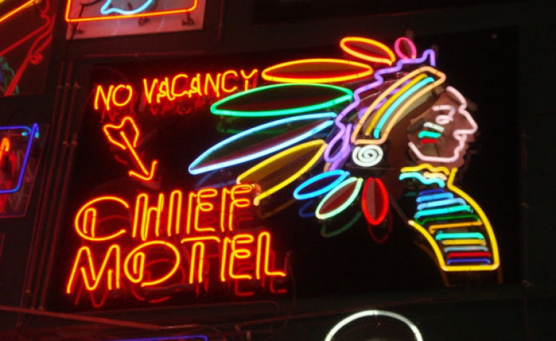 Chief Motel sign made with neon text and a colorful neon chief.