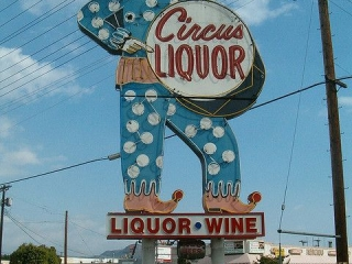Although the photo was taken during the day, this cool vintage sign for Circus Liquor illuminates during the night.
