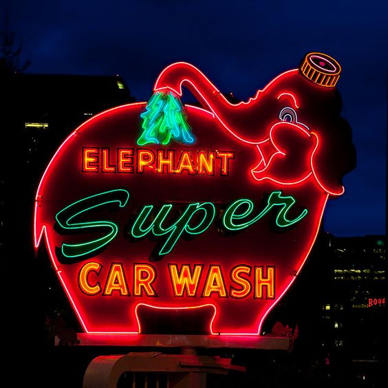 Giant elephant neon sign for Elephant Super Car Wash in Seattle, WA.