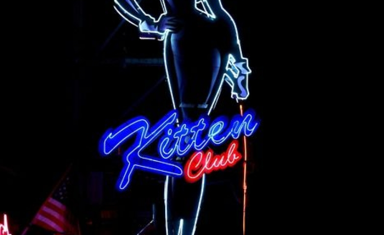 "Giant Catwoman figure with neon wire and the name ""Kitten Club"" neon sign."