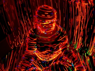 """""""Light Man"""" concept created using neon light to contour the shapes."""