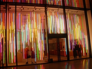 Louis Vuitton used colored neon lightning for the store window display.