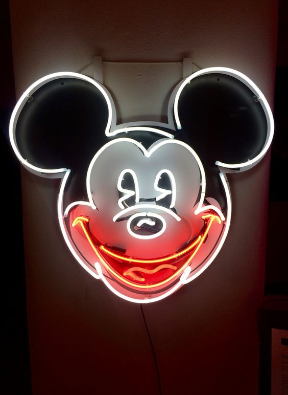 The iconic Mickey Mouse head neon sign hanged on a wall.