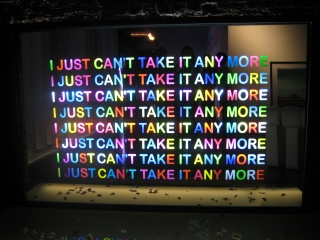 """Modern neon design with the text """"I just can't take it anymore""""."""