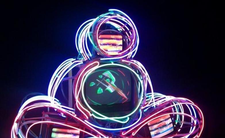 Artist Nam June Paik created this neon Buddha using neon lighting.