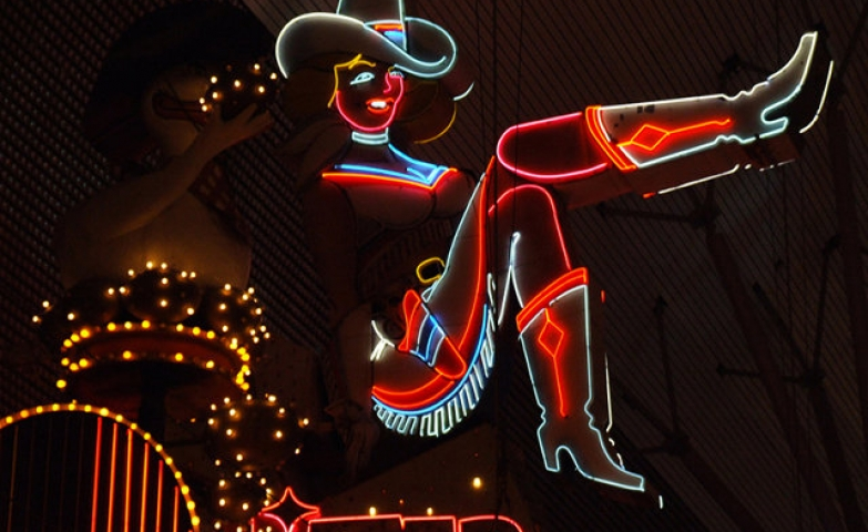 Neon cowgirl lady sign, inspiration for a western themed place.