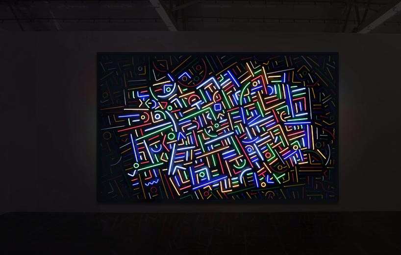 Intriguing piece with neon light placed abstractly inside a huge rectangle.