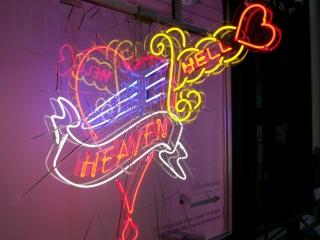 Dagger piercing through the heart, a Heaven & Hell concept created using neon light.
