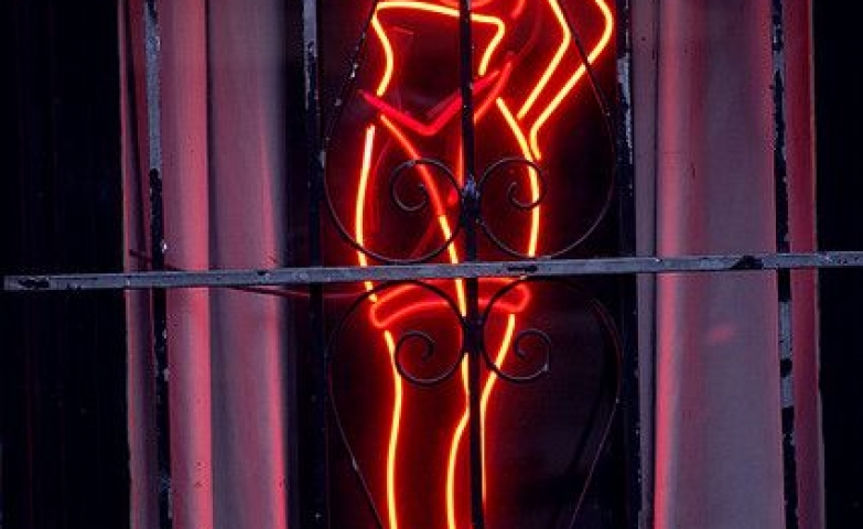 Figure of a blonde lady in underwear, sexy figure made with neon light.