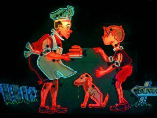 A scene with people created with neon light, showing a chef, a boy and a dog.