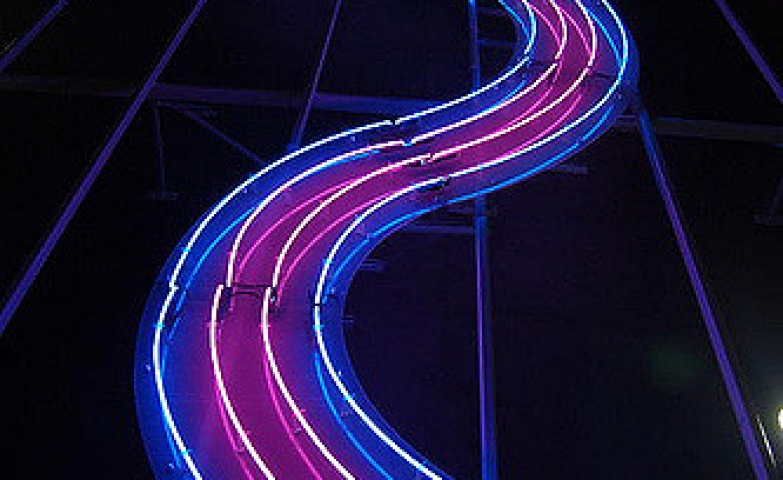 A road with many curbs made with four wires of neon light.