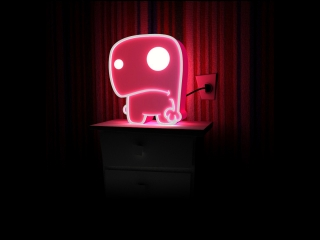 Very cute little cartoon sign made with neon light and placed on a stand.