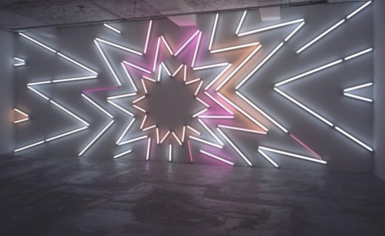 Stunning wall installation created by using abstract neon sign art.