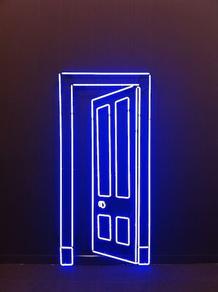 A door sign made only from blue color neon wire.
