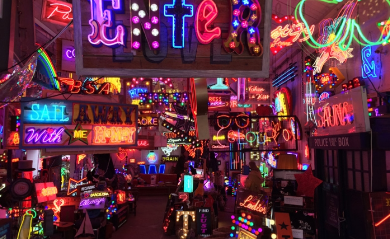 A diversity shop full of all kinds of different neon signs.