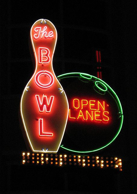 Sign for The Bowl representing a bowling pin and ball made with neon.