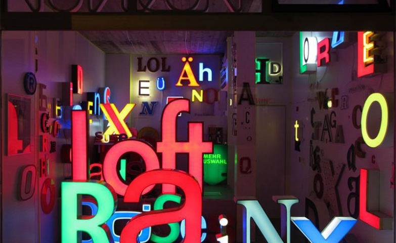 What you can see here is a window display for a neon shop with many different neon letters and styles.