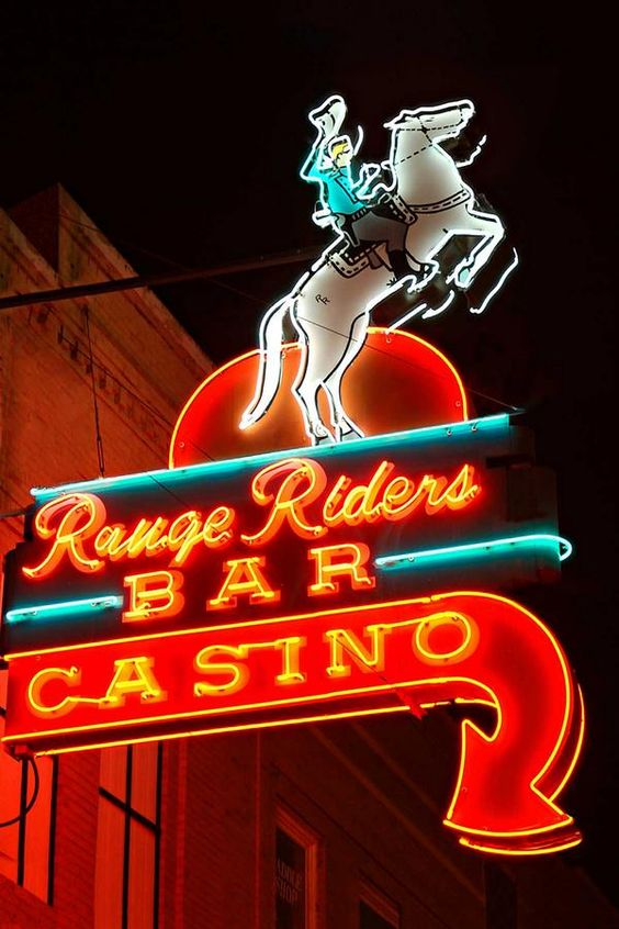 Typical vintage casino neon sign for the Range Riders Bar Casino.
