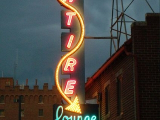 Satire Lounge and its neon signs which can be seen driving along the way.