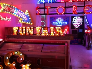 The inside of a store that sells neon lights signs.