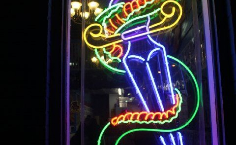 Snake and dagger neon sign for The Mohawk, a club in Austin, TX.