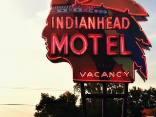 Vintage neon sign is combined into a perfect harmony with the rest of the natural setting, for the Indianhead Motel in Wisconsin.