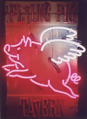 Neon sign for the Flying Pig Tavern with creative design in the shape of you guessed it, a flying pig.