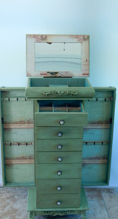 Green jewelry armoire with mirror