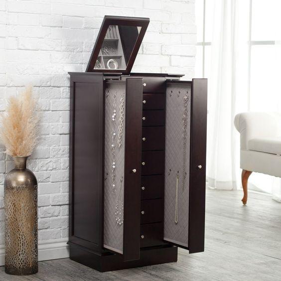 Glamorous espresso jewelry armoire with sliding doors