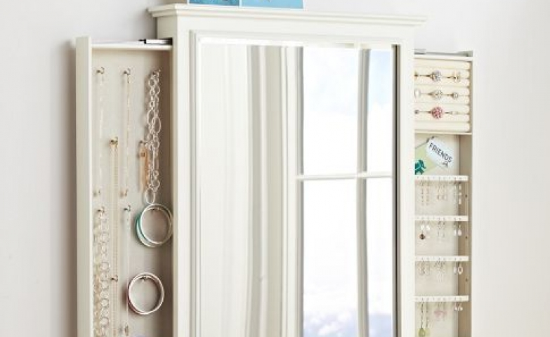 Compact wall mounted jewelry armoire with sliding doors
