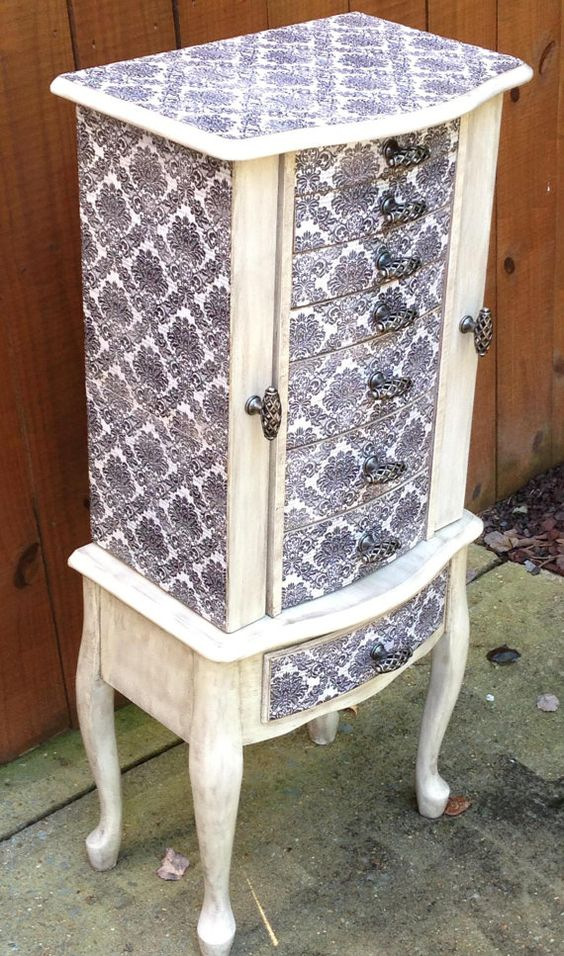 White jewelry armoire with vintage print