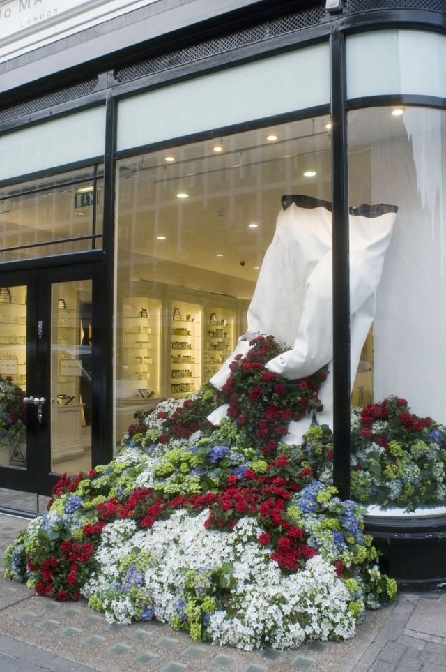 White glove and spring flowers window display