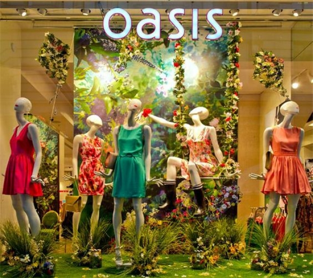 Oasis spring window display vivid green backdrop