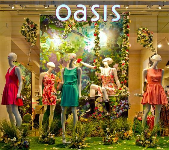 Oasis spring window display vivid green backdrop