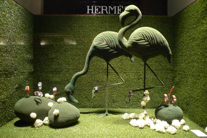 Green flamingos Hermes window display