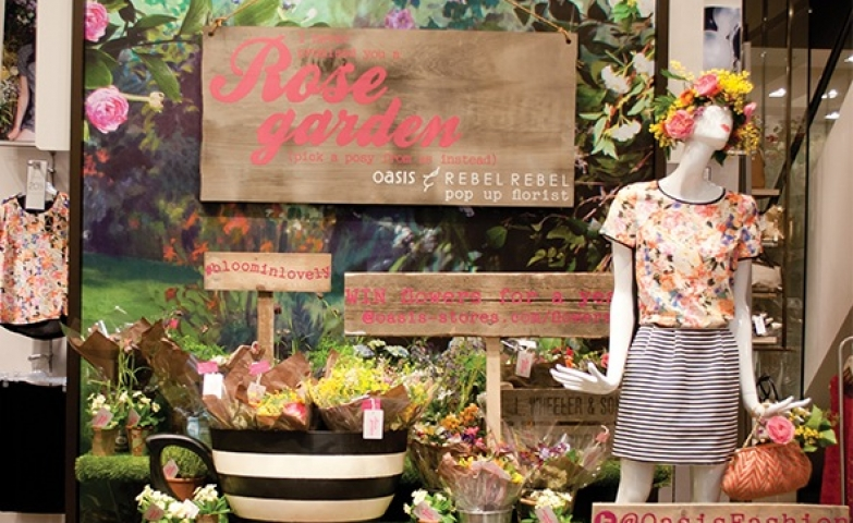 Gorgeous oasis flower pop up stall spring window display