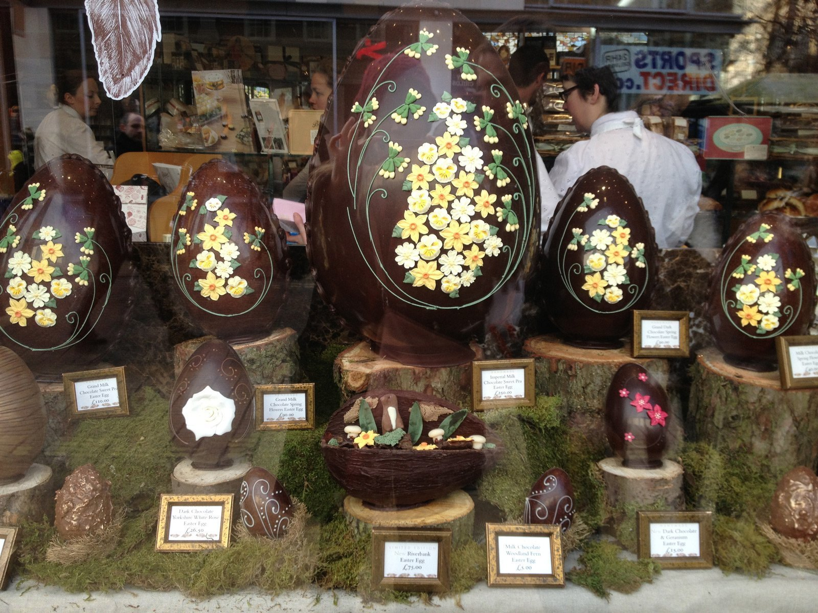 Adorned chocolate eggs for Easter, placed on an artificial moss, is giving the window display the air of the Easter.