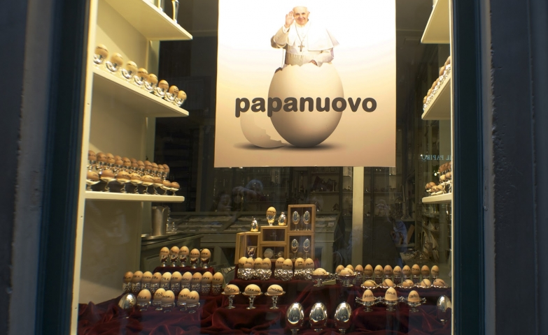 Out of the ordinary, this window display it is decorated for Easter with a banner with Pope popping out of an egg and with silvery eggs.