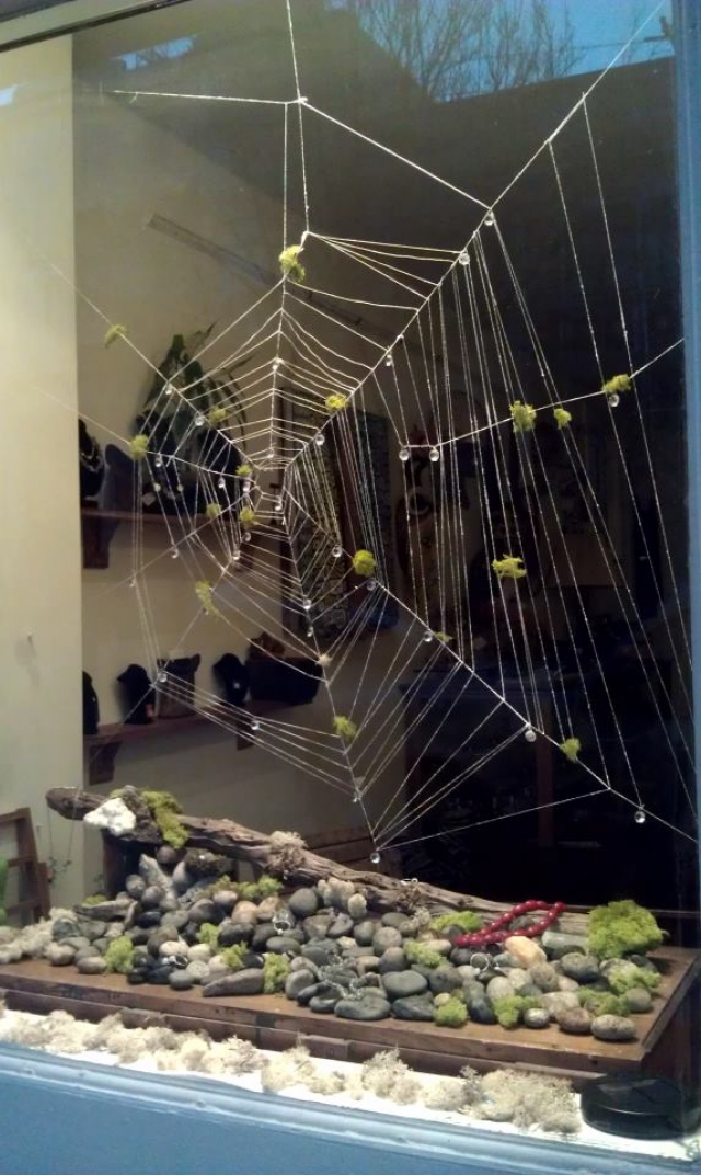 The bead store spider web spring window display