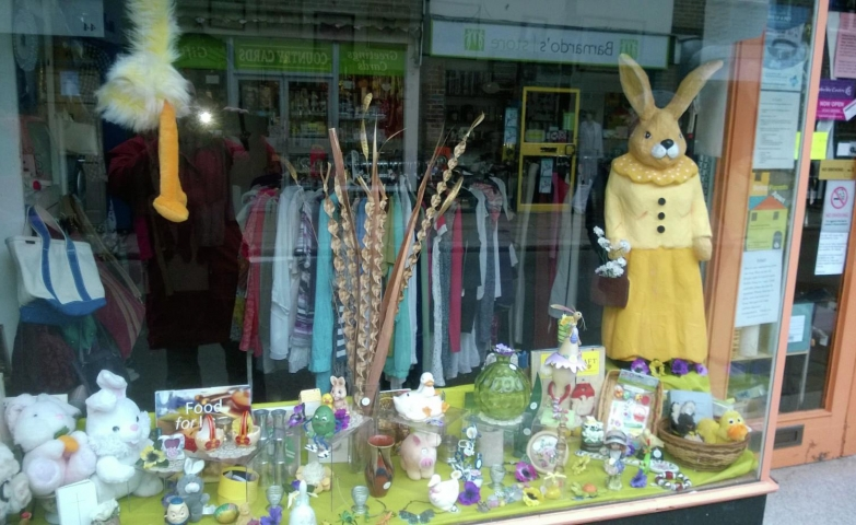 This window display was decorated for Easter with a big, plush bunny dressed like an old lady.