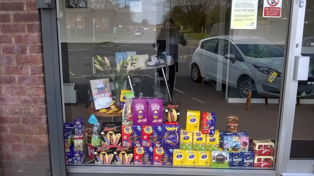 They choose a few boxes of sweets for the easter window display. There are chocolate eggs collection from different chocolate brands.