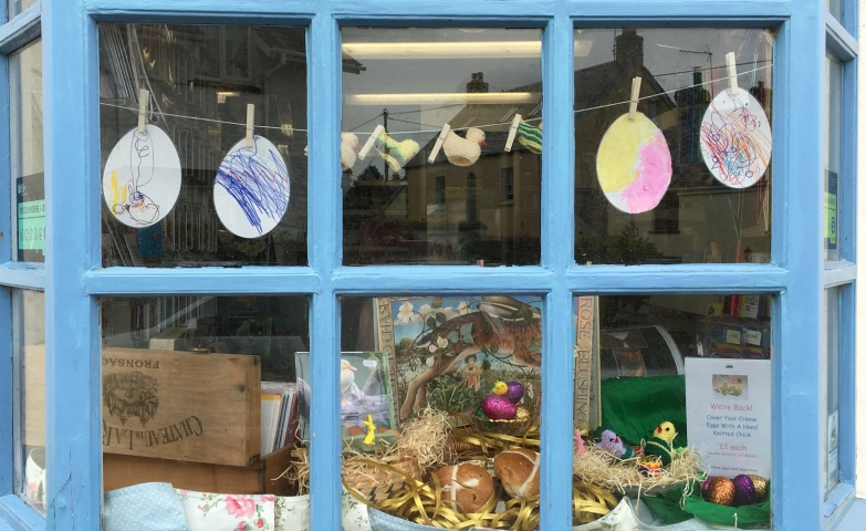 A colorful Easter window display, made by children of West Down Primary Schoo, with colored eggs and other cute details.