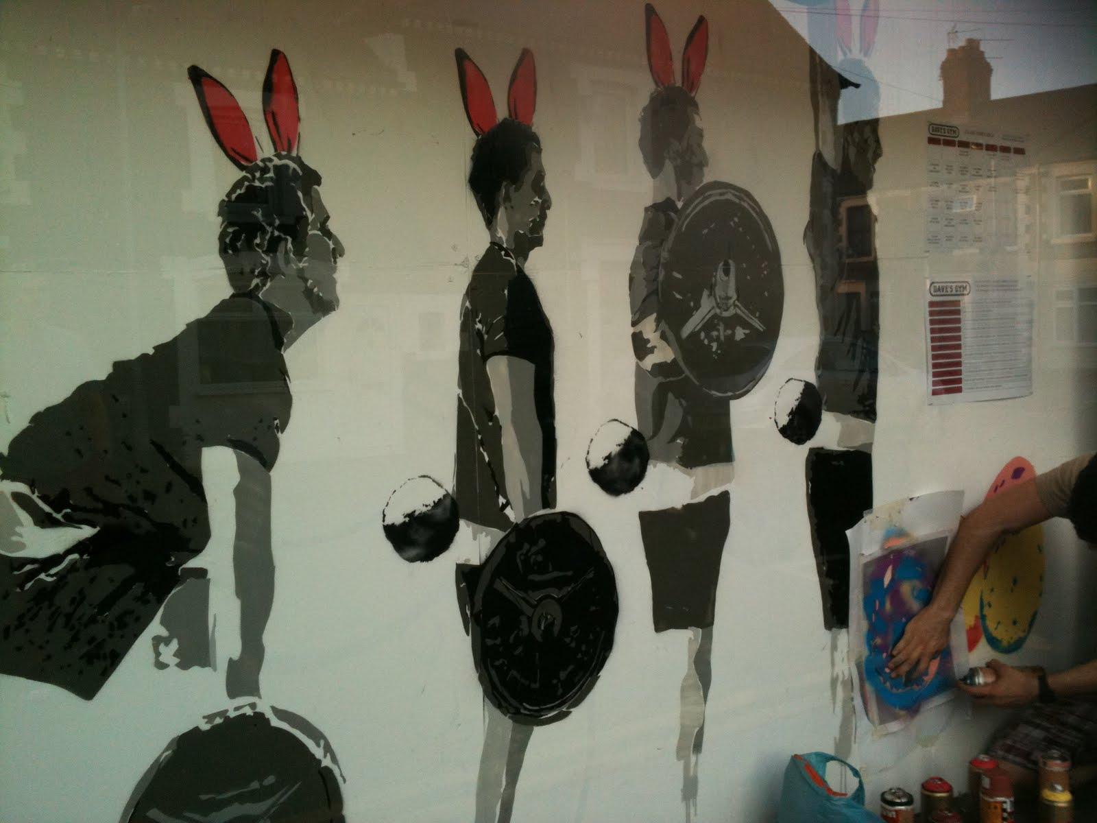 A gym window display with a twist for Easter given by the in-house graffiti artist, Remed Aran.